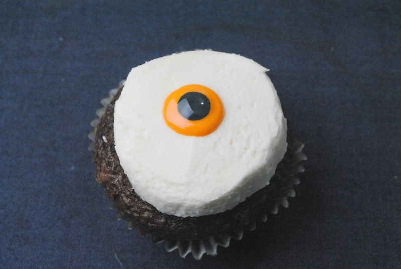 Bloodshot Eyeball Cupcakes Recipe - Your guests won't be able to take their eyes off of these homemade cupcakes decorated to look like bloodshot eyeballs!