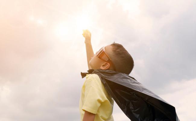child in cape