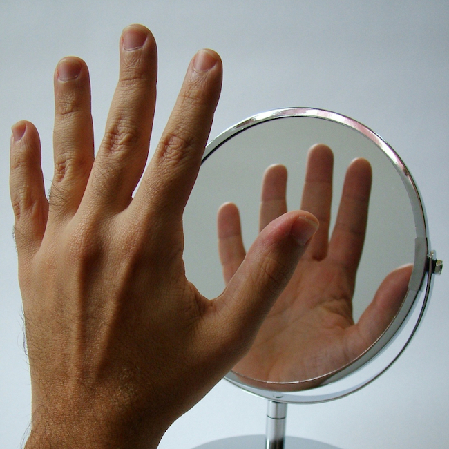 hand in mirror